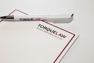 Torque Law headed paper and pen