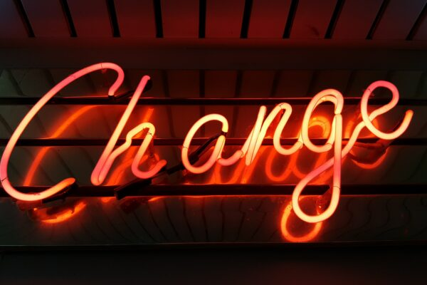 The word 'change' in neon lights